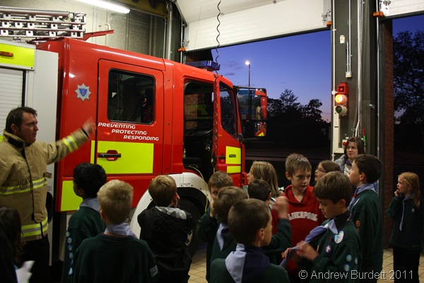 THIS IS THE ENGINE_One of the permanently-based firemen shows the Cubs the fire-engine.
