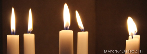 KEEP SHINING BRIGHT_Candles burning at the Christmas Day service today.