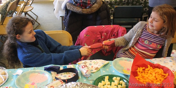 TUG: Two girls share a cracker. (IMG_2020)