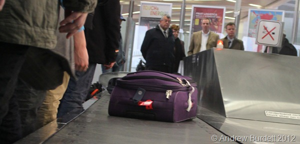 BAG GRAB: Collecting bags off the conveyor belt. (IMG_7392)