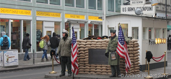 STANDING GUARD: Two men, dressed as US soldiers, pretend to man a mock-up of Checkpoint Charlie for tourists' photographs. (IMG_7695)