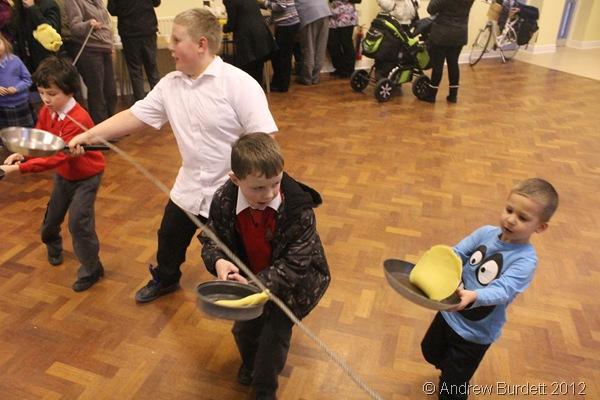 PHOTO FINISH: Four children, tossing pancakes, cross the finishing line. (IMG_8343)