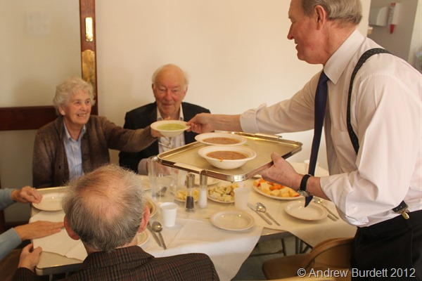 WE'RE HAVING A BOWL: Roger Clarke helps distribute soup bowls. (IMG_8592)