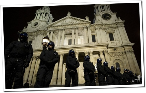 ALMIGHTY FORCE: Police moved in to clear the protest camp in the dead of night.