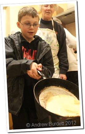 WHAT THE FLIP: A child at the church's Pancake Party on Tuesday prepares to toss their pancake. (IMG_8370)