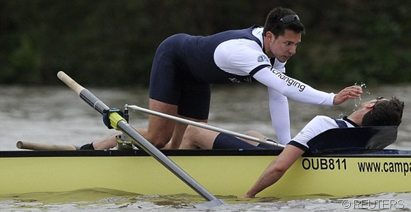 FIRST AID: Oxford box Dr Alex Woods appeared to have fainted, so team-mate William Zeng attempted to bring him round.