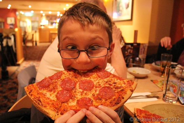 BITING OFF MORE HE CAN CHEW: A younger Sparkler enjoys a giant pizza at Pizza Hut. (IMG_1262)