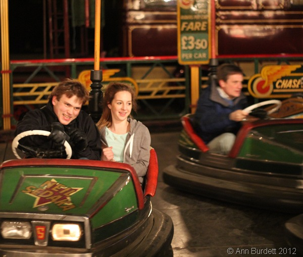 TAKING HER FOR A RIDE: Year 10 girl Georgia Austin joined me on the dodgems, while my father put on a more serious face in his dodgem car. (IMG_2844)
