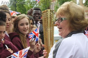 MEET AND GREET: Claire's Court Schools pupils speak to the torchbearer. (IMG_8159_AMB)