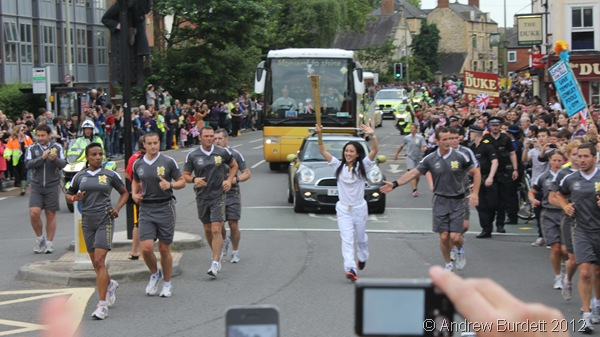 TIME TO SHINE: One of the last Torchbearers of the day runs her stint. (IMG_8523/OXFORD)