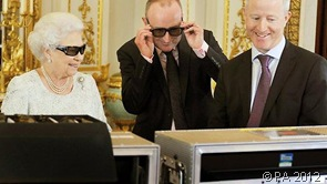 LOOKING SLICK: Images of the Queen reviewing her Christmas message, wearing 3D spectacles, have attracted attention on social media.
