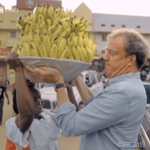 TAKE THE STRAIN: Clarkson barely managed to hold the massive bowl of bananas.