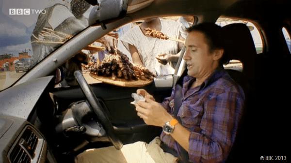 WINDOW-SHOPPING: Richard Hammond buying breakfast through his car window.