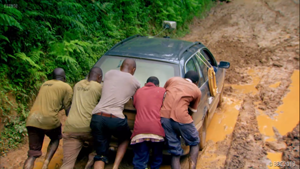 GET IT MOVING: The Ugandan Army lend a hand with getting Clarkson's mud-trapped car on the move, while training in the beautiful but boggy countryside.