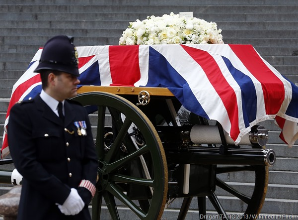 ROLLING BY: The gun-carriage carrying Thatcher's coffin is processed through London.