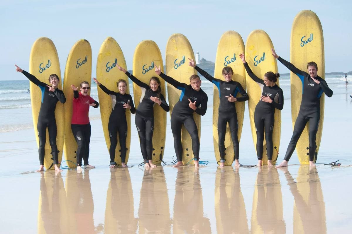 Andrew Burdett and other Explorers pose for a photograph with hired surfboards.
