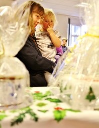 Although many of the fundraising fair's attendees are of an older generation, this mother brought along her daughter to help decide on which jar to buy. (Photo: © Andrew Burdett 2013)