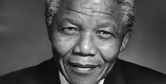 A black-and-white picture of a smiling Nelson Mandela, who died today.