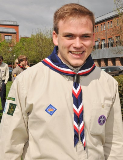 Andrew Burdett in Scout uniform with, on right breast, his Queen's Scout badge.