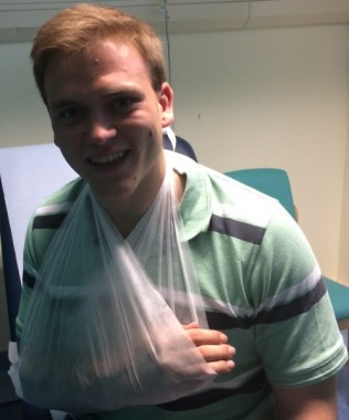 Andrew Burdett with his arm in a sling, following the accident.