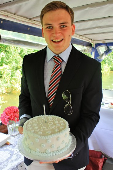 Andrew Burdett holding a cake, made and decorated by father Richard Burdett, in celebration of his 18th birthday party.