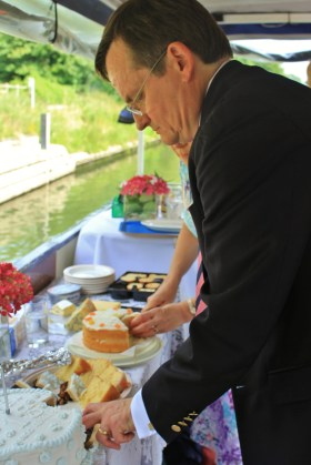 After Andrew had made the first incision, the cakes were sliced further for guests to enjoy.