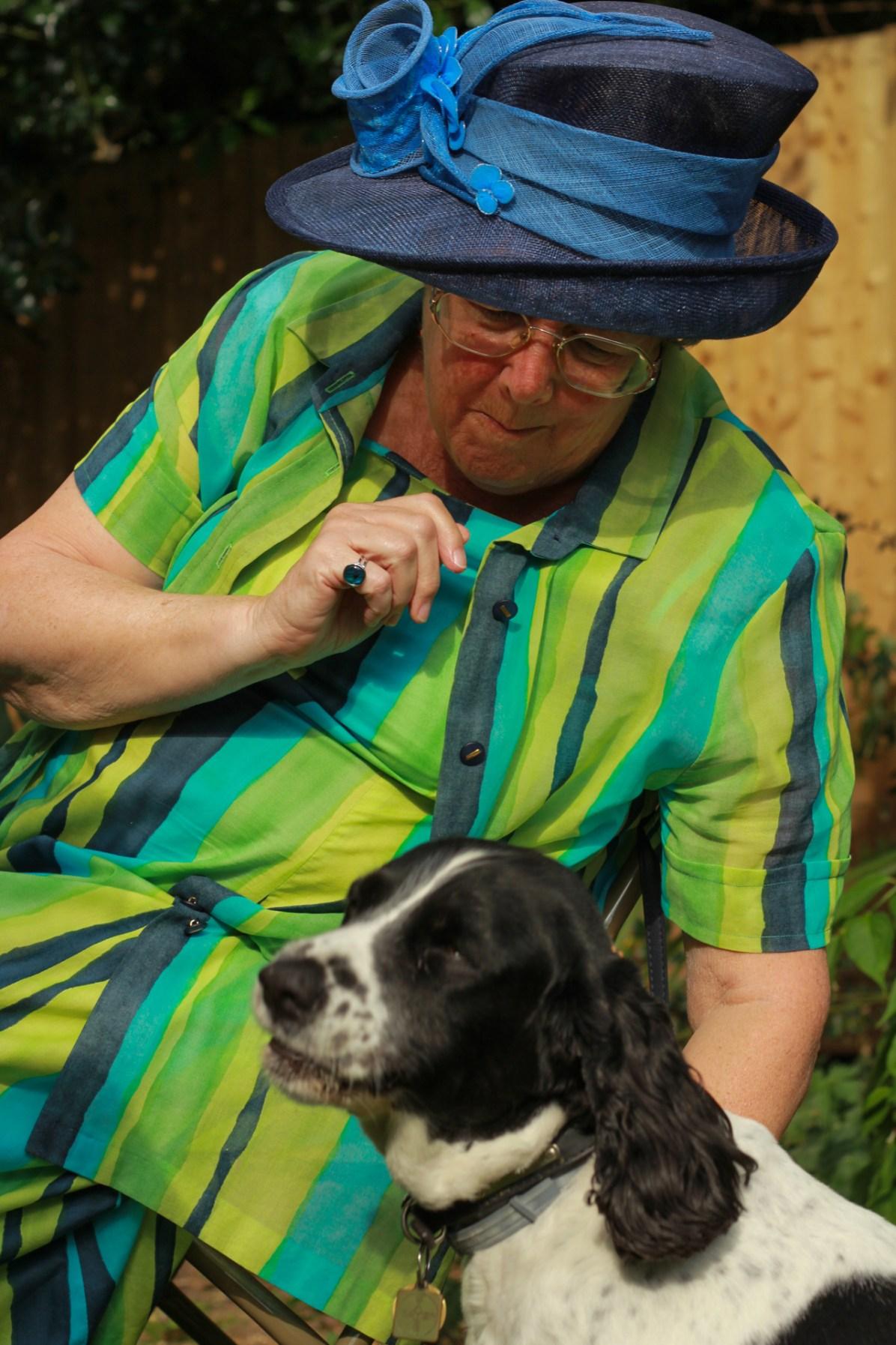 Lily, vicar Sally's spaniel, enjoys a cake with Johanna Raffin.