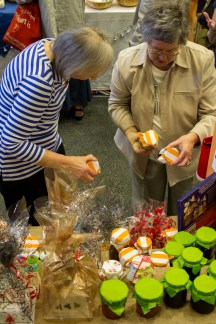 Two shoppers take their pick of St Luke's jellies and jams.