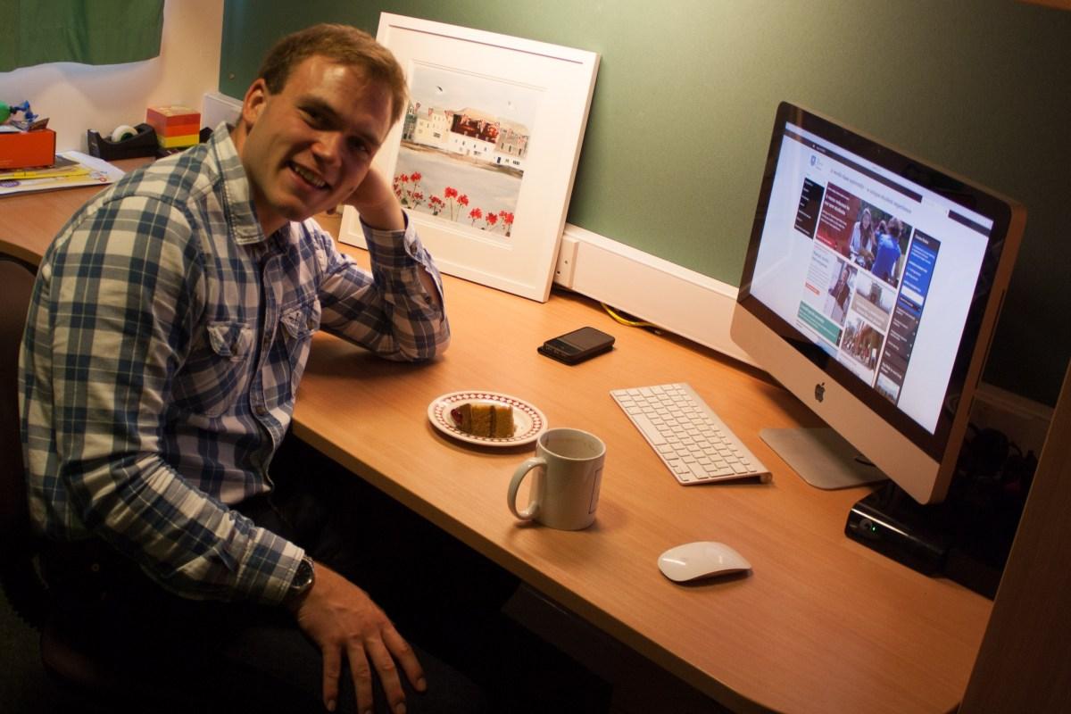 Andrew Burdett sat at his new desk in Sheffield.