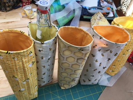 bottle bags made with bee and honeycomb patterned fabric
