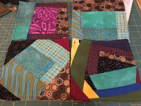 "squares of multiple textiles sewn together and then cut down to 6 1/2"" squares"