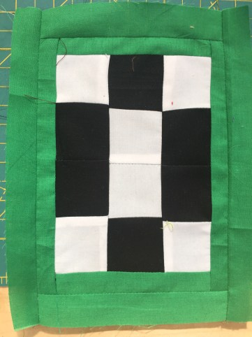 sign of carcer executed in quilting cotton: green, black, white