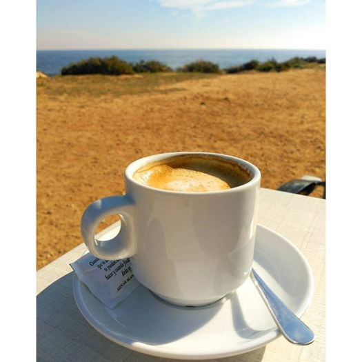 A cup of coffee near at Rocio del Mar Beach