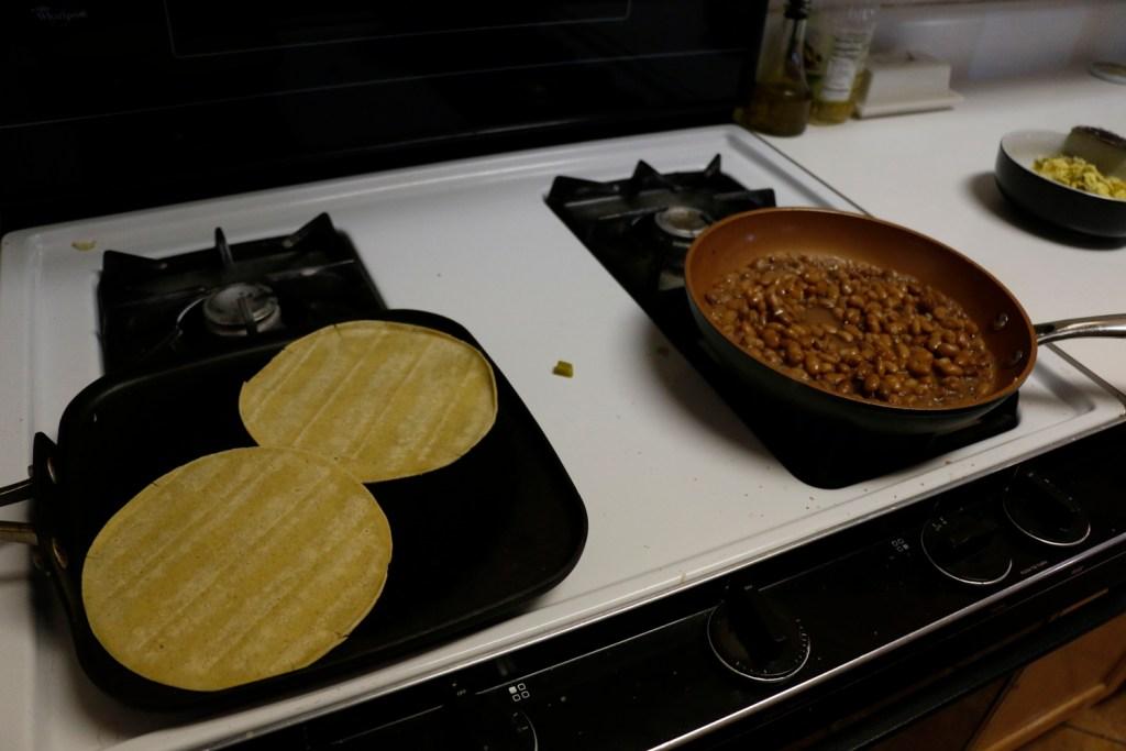 corn tortillas on a flat pan