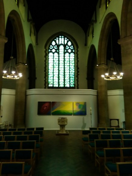 St Barnabas Southfields (London UK). The nave, baptistry,, looking west. [Source: Andrew Pink © 2019]