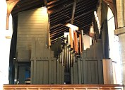 The organ in St Barnabas Southfields, viewed from the north aisle, looking east. Source: London Churches in Photographs https://londonchurchbuildings.com