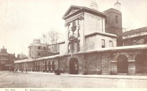 St Bartholomew's Hospital, Smithfield, c.1890, Henry VIII Gate (1703) with the church of St Bartholomew the Less behind.