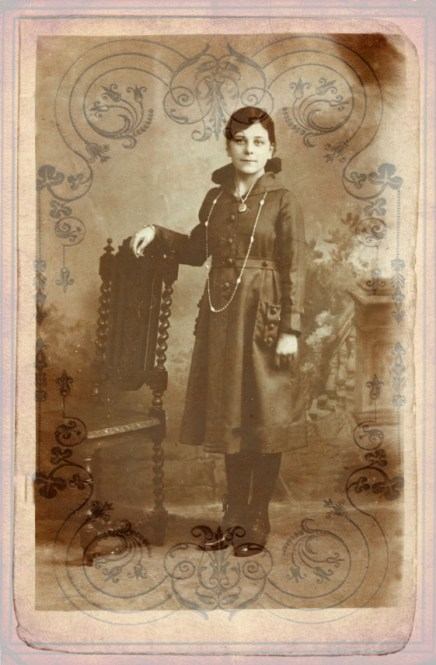 A damaged vintage photograph of a young woman. Would make a good example for 'before' bit of photo restoration tutorial.