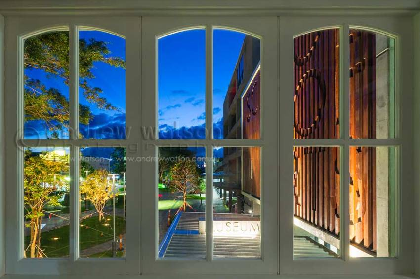 View of new School of Arts building extension, Cairns, through heritage building windows