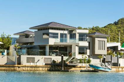 Image of waterfront home from canal in Bluewater Estate, Cairns