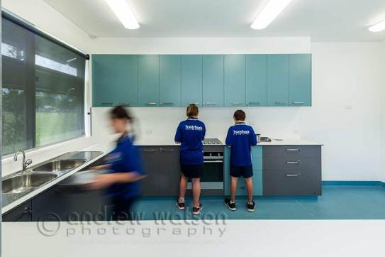 Image of school children using kitchen facilities in school