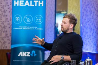 Image of Dylan Alcott speaking at Cairns breakfast function