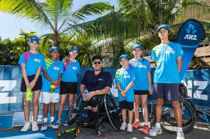Image of Dylan Alcott and helpers at ANZ Cairns Charity Tennis Challenge