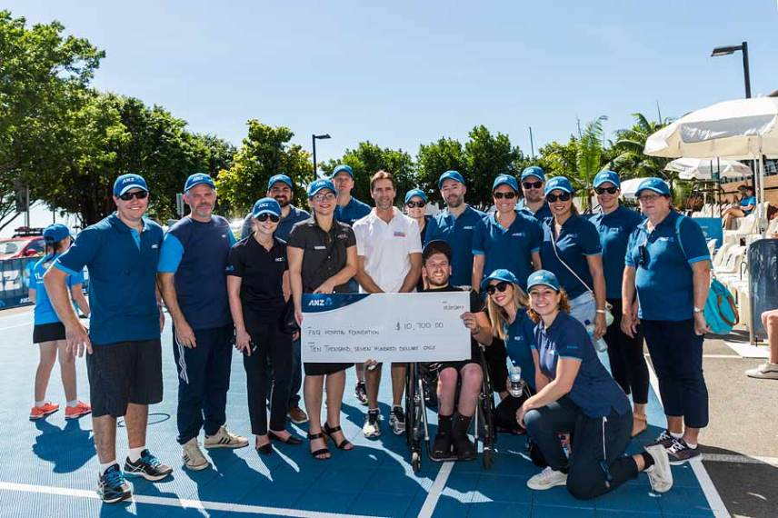 Image of Dylan Alcott presenting charity cheque in Cairns