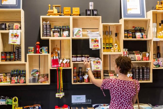 Image of woman browsing products at the Sarina Sugar Shed