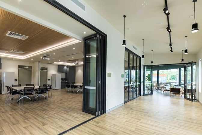 Interior of Wellbeing centre with meeting room and cafe entrance