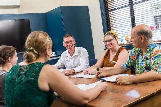 Group of school teachers talking in a meeting room