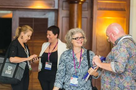 Delegates networking at conference function