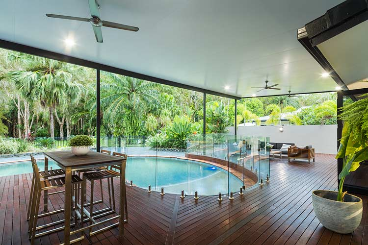 Wooden deck and swimming pool of Kewarra Beach residential home