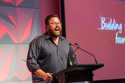 Shane Jacobson speaking onstage at Bridestone Conference